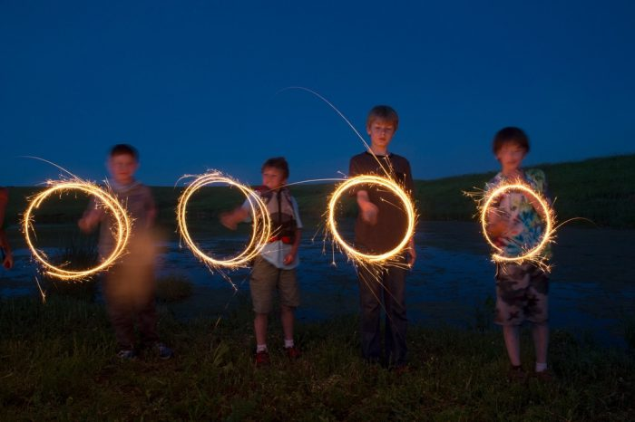 Photo: Four young boys play with sparklers at the Valparaiso pond in Valparaiso, Nebraska.