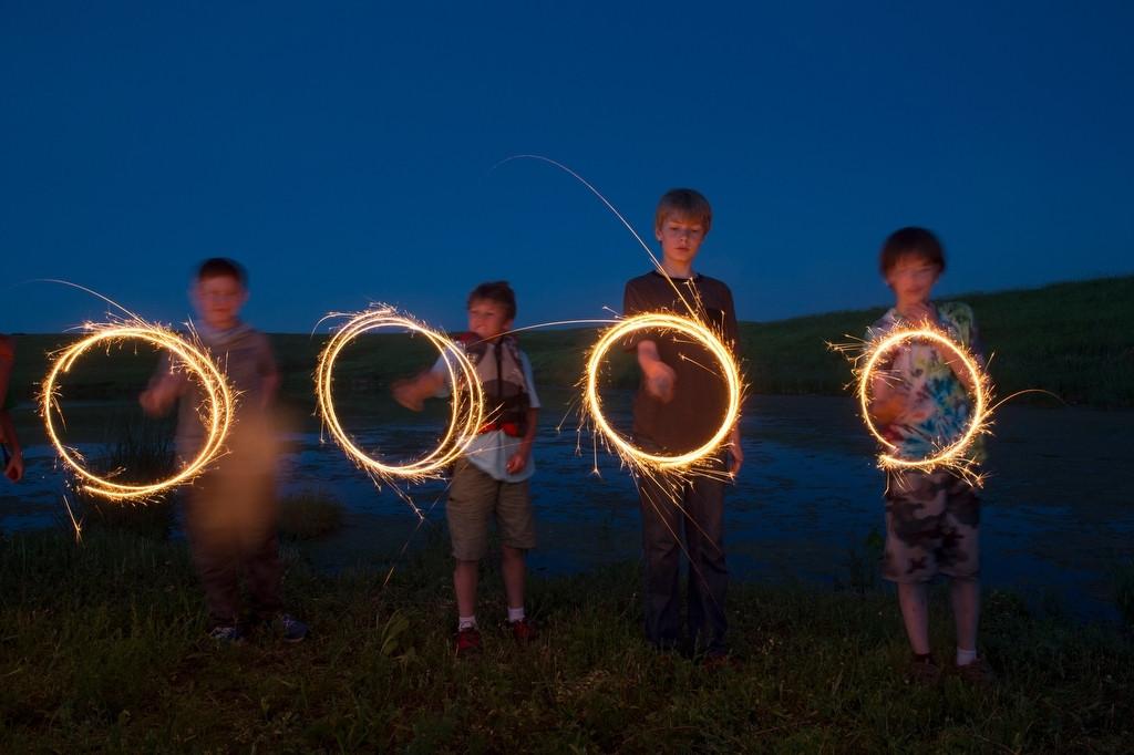 Photo: Four young boys play with sparklers at the Valparaiso pond in Valparaiso, Nebraska.