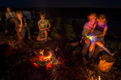 Photo: A family gathers around a campfire at the Valparaiso pond in Valparaiso, Nebraska.