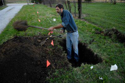 Photo: A man repairs a water leak at Waveland Farm near Walton, NE.