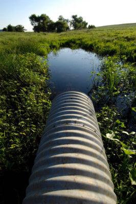 Photo: A culvert sends runoff toward a farm pond near Dunbar, NE.