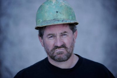 Photo: A construction worker wears a hardhat.