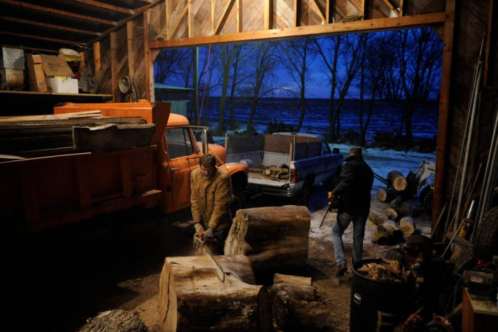 Photo: Sawing wood on a family farm near Cortland.