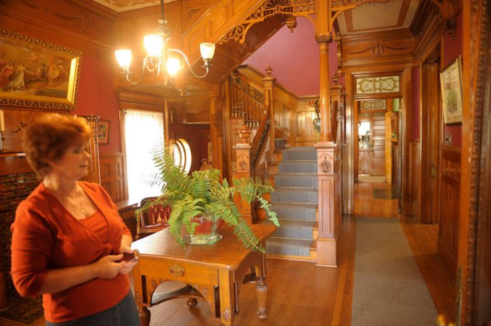 Photo: A realtor inside a historic home for sale in Marysville, KS.