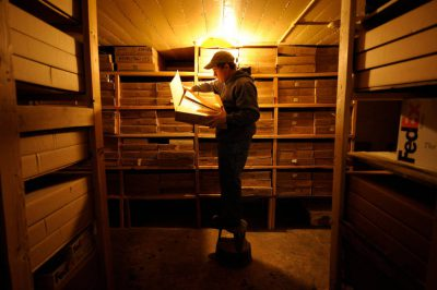 Photo: Joel Sartore rummages through slide film in his storage room in Lincoln, Nebraska.