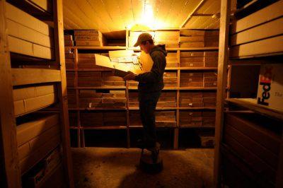 Photo: Joel Sartore rummages through slide film in his storage room in Lincoln, Nebraska.