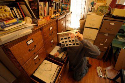 Photo: Joel displays old slide film from storage.