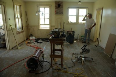 Photo: A carpenter takes a break during restoration of a farmhouse in Dunbar, Nebraska.
