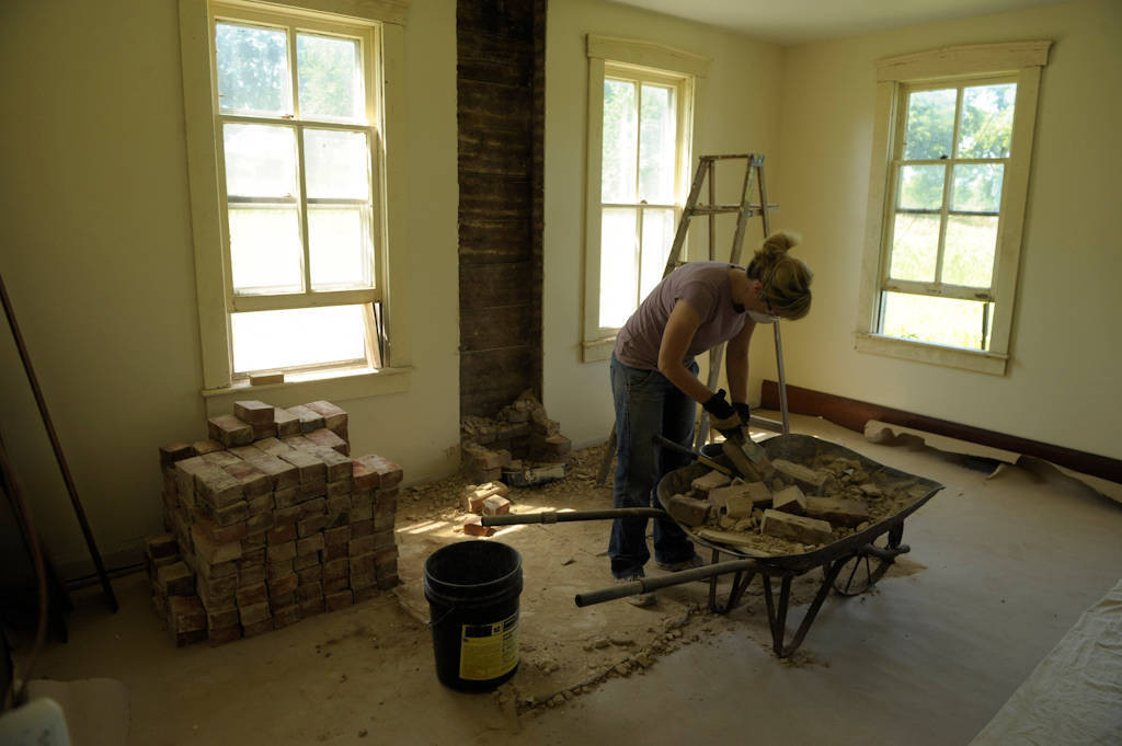 Photo: A worker cleans bricks during restoration of a farmhouse in Dunbar, Nebraska.