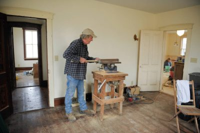 Photo: A carpenter restores a farmhouse near Dunbar, Nebraska.