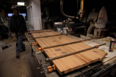 Photo: A carpenter glues pieces of redwood together to form a countertop.