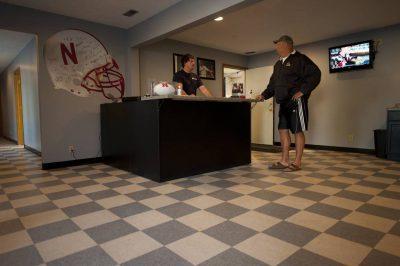Photo: Two men discuss a car problem at an auto shop.