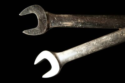 Photo: A close up of a pair of wrenches.
