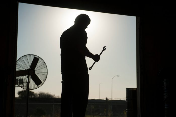 Photo: A mechanic's silhouette.