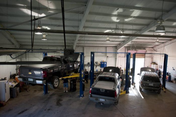 Photo: Mechanics hard at work at an auto body shop.