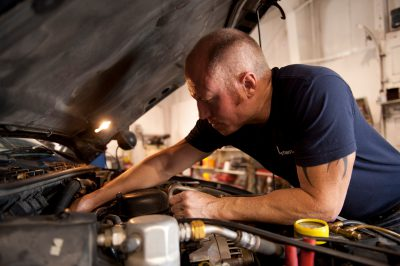 Photo: A mechanic checks a car's engine in Lincoln, Nebraska.