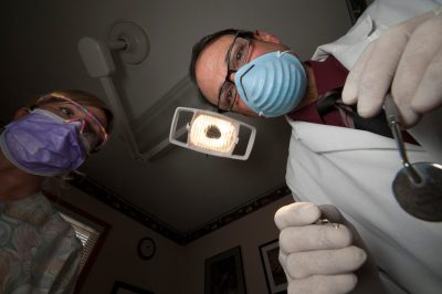 Photo: A dentist and his assistant in Omaha, Nebraska, USA.