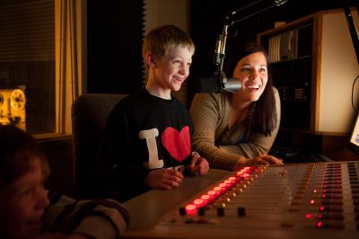 Photo: A young boy helps a DJ in Lincoln, Nebraska.