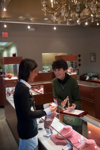 Photo: A woman picks out jewelry at a jewelry store in Lincoln, Nebraska.