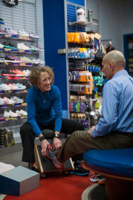 Photo: A woman helps a man pick out athletic shoes at a sporting goods store in Lincoln, Nebraska.