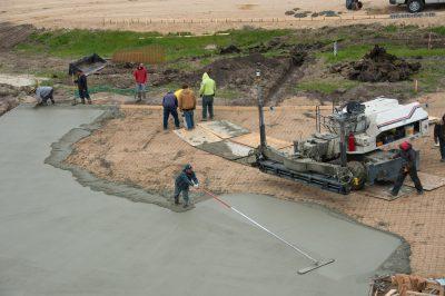 Photo: A construction crew pours concrete.