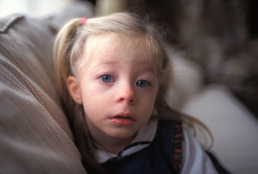 Photo: A young girl looks surprised as her picture is taken in her home in Lincoln.