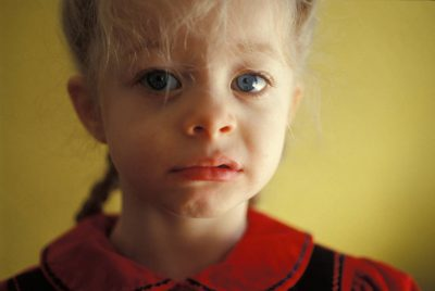 Photo: A young girl's lip quivers in anticipation of a cry.