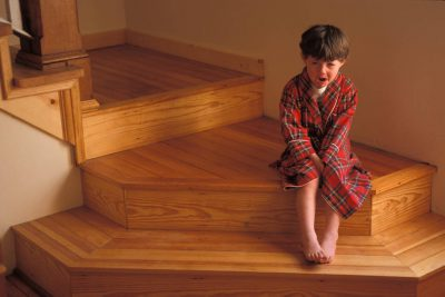 Photo: A young boy cries on the stairway after being scolded.