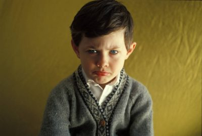 Photo: A young boy pouts in his home in Lincoln, Nebraska.