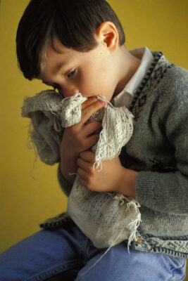 Photo: A young boy pouts in his home in Lincoln, Nebraska as he hugs his blanket.