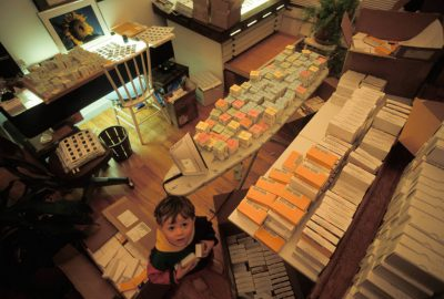 Photo: A curious boy looks at slides in his father's office.