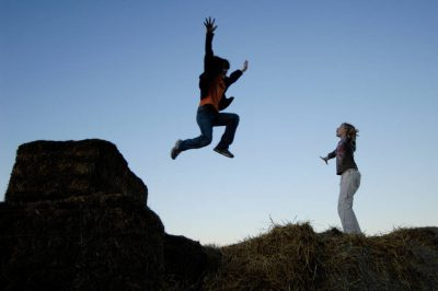 Photo: Kids jump off of hay bales at a pumpkin patch near Roca, NE.