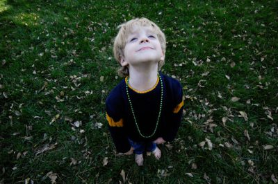 Photo: A 4-year-old boy makes a face at the camera in the backyard of his Lincoln, NE home.