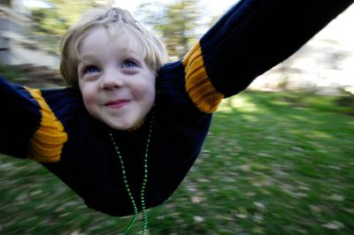 Photo: A 4-year-old boy gets swung in circles in his backyard in Lincoln, NE.