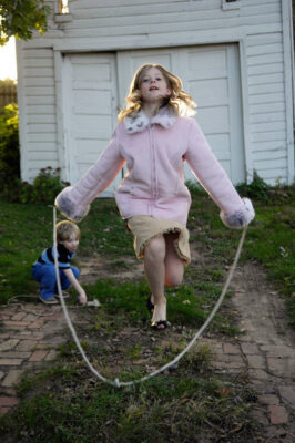 Photo: A 10-year old girl skips rope.