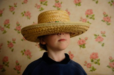 Photo: A 4-year-old boy plays dress-up in the home of his grandmother.