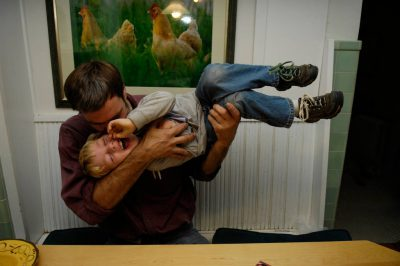 Photo: A man plays with his five-year-old son.
