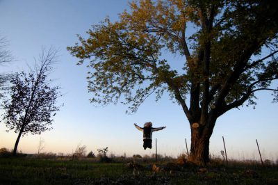 Photo: A 10-year-old girl loves nature at Thornhill Farm near Princeton, NE.