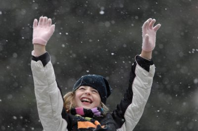Photo: A 10-year-old spends time outside during the first snow of the winter season.