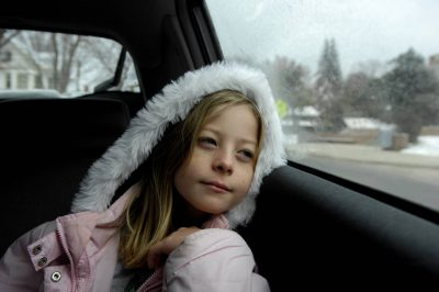 Photo: A 10-year-old girl rides in the backseat of a car.