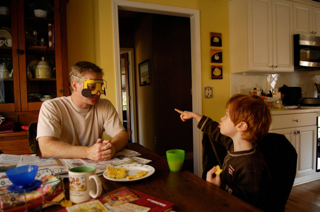 Photo: A 3-year-old boy eats breakfast at his home.