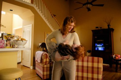 Photo: A mother and son play in their living room.