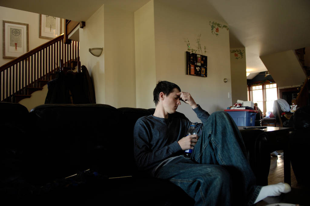 Photo: A 16-year-old boy looks distraught in his home.