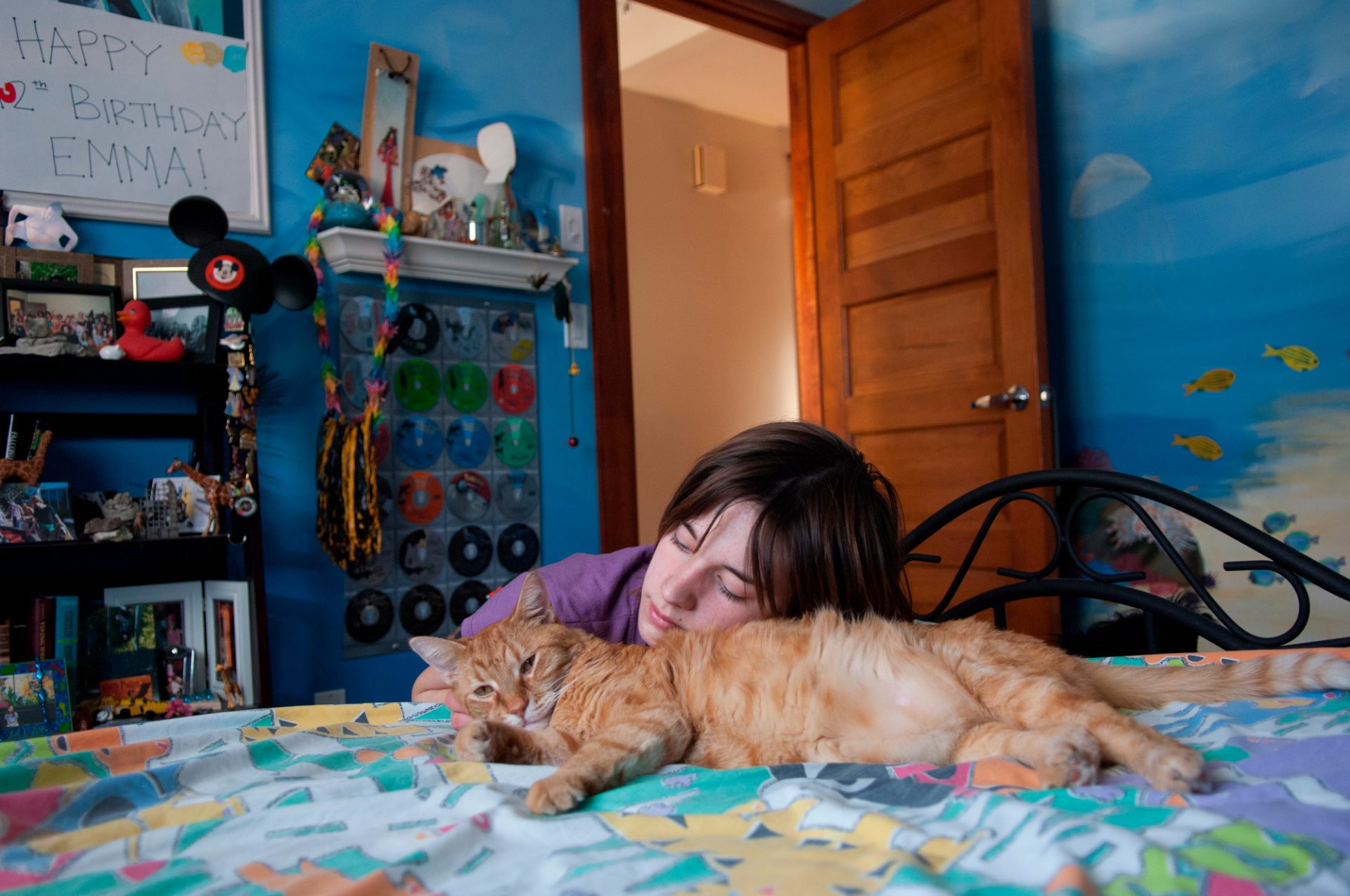 Photo: A 14-year-old girl with her pet cat.