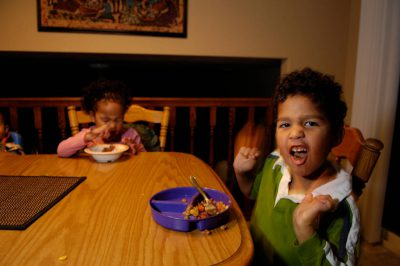 Photo: Sibilings eat dinnder in their suburban home in Lincoln, Nebraska.