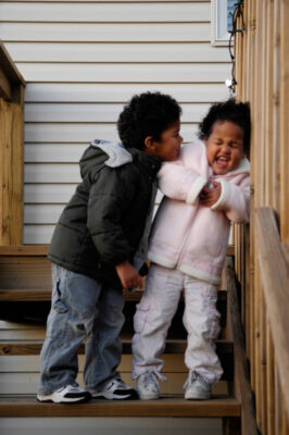 Photo: A brother and sister play together outside their suburban home in Lincoln, Nebraska.