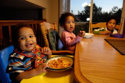 Photo: Three siblings eat dinner in their suburban hoome in Lincoln, Nebraska.