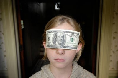 Photo: A 10-year old girl wears a $100 mask.