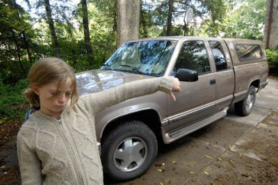 "Photo: A 10-year-old expresses her disapproval for ""gas guzzlers."""