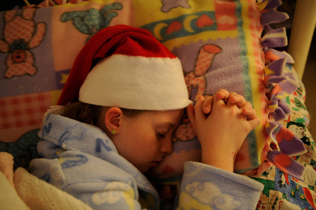 Photo: A 10-year-old girl falls asleep in a stocking cap.